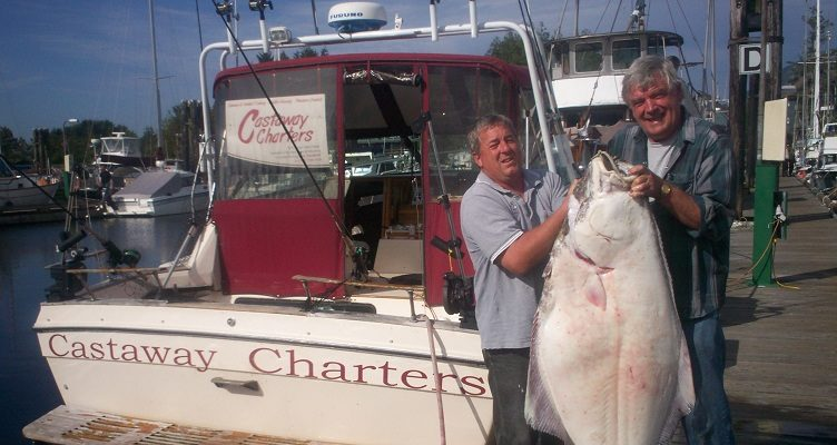 Paul holding up a very large halibut