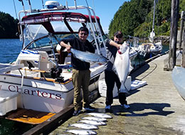 Paul with a giant halibut fish